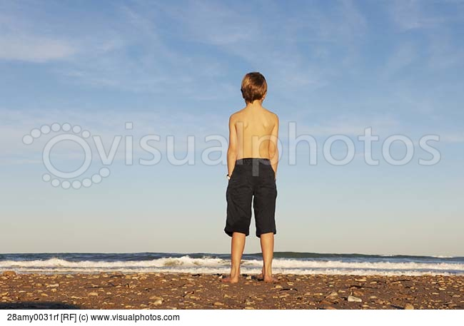 boy-on-beach-looking-out-to-sea